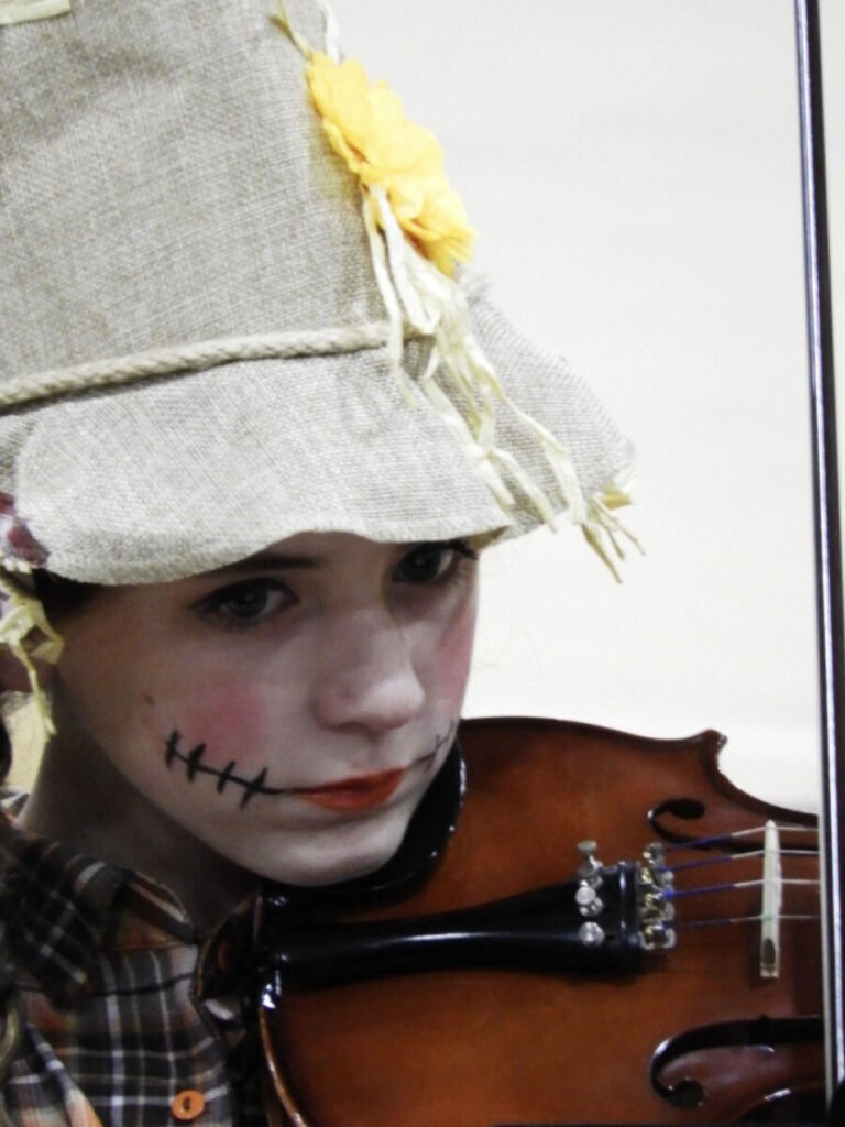 Sherrard Middle School 7th grader Brielle Gregware performing dressed as a scarecrow.