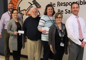 Monday morning Tom O'Connor, a trustee from the Karl and Mildred Niekamp Charitable Foundation, presented Moundsville Middle School principals and teachers with two checks totaling $25,000.